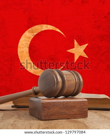 Wooden gavel and vintage Turkey flag - stock photo