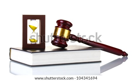 wooden gavel, book and hourglass isolated on white - stock photo