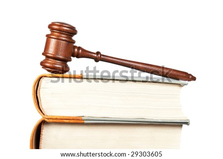 Wooden gavel from the court and law books isolated on white background. Shallow depth of field - stock photo