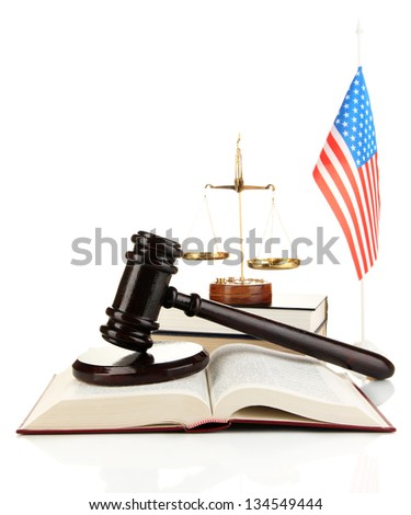 Wooden gavel, golden scales of justice, books and American flag isolated on white - stock photo