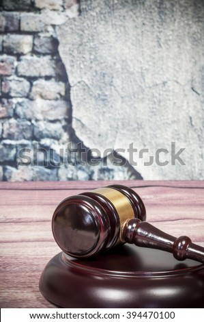 Wooden gavel on a vintage wall background - stock photo