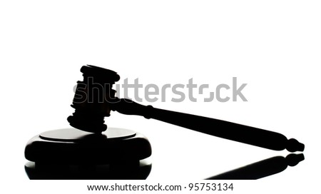 wooden gavel on gray background