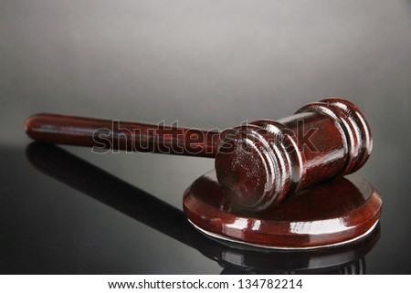 Wooden gavel on grey background - stock photo