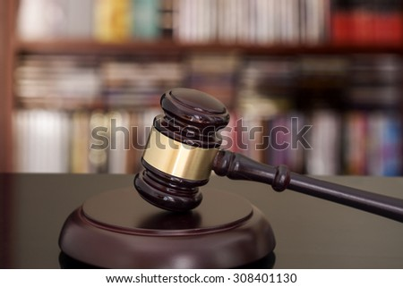 Wooden gavel on library background