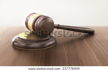 Wooden gavel on the table on blurred background - stock photo