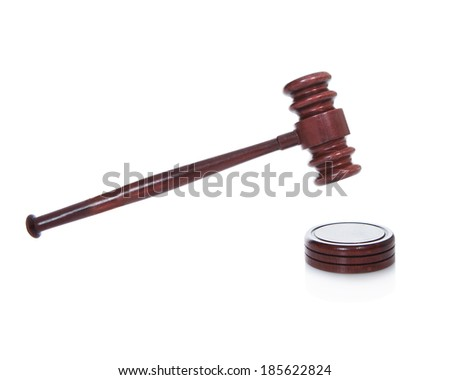Wooden gavel or mallet as used by a judge in a courtroom or an auctioneer isolated on white - stock photo