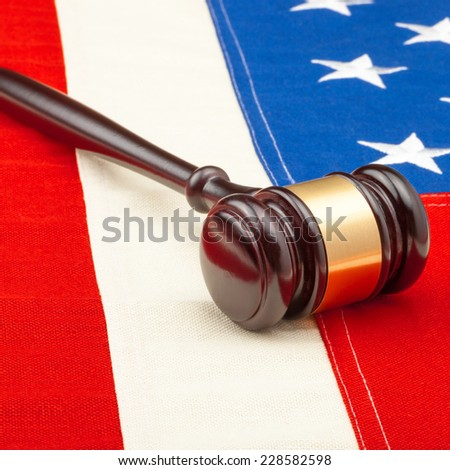 Wooden gavel over USA flag - stock photo