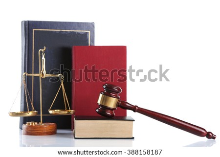 Wooden gavel with justice scales and books, isolated on white