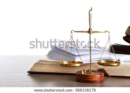 Wooden gavel with justice scales and open books on white background - stock photo