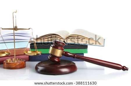 Wooden gavel with justice scales and stacks of books, isolated on white - stock photo