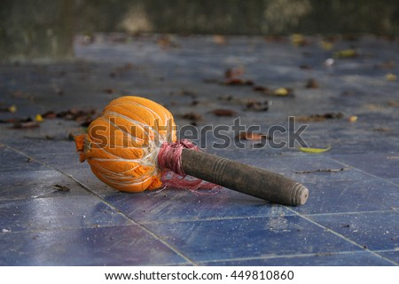Wooden gong mallet in temple - stock photo