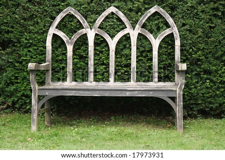Wooden Gothic style Bench in an English country garden