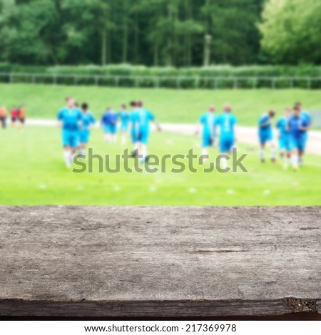wooden gray top of free space with green grass  - stock photo