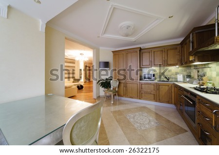 wooden greater kitchen in a modern apartment - stock photo