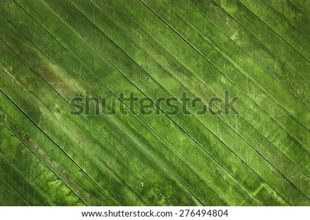 Wooden green background from natural fibers of different designs - stock photo
