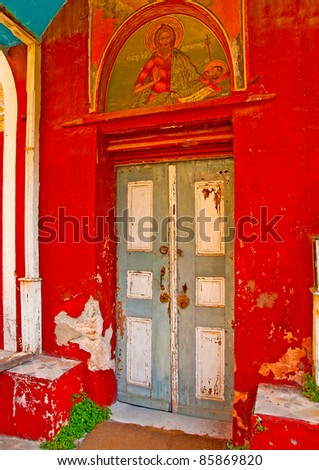 Wooden grey door of an old church in monastery Iviron in holy mountain Athos in Greece - stock photo