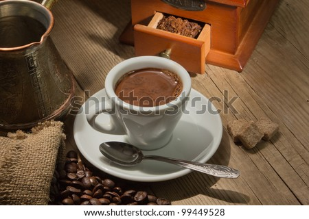 Wooden grinder with coffee beans on the tree with a bag - stock photo