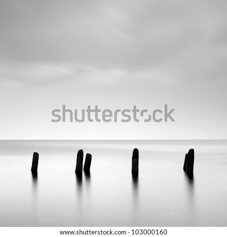 Wooden groynes in the sea off the Ayrshire coast, Scotland