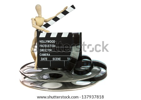 Wooden guy with Movie Clapper Board with film reel on white background - stock photo