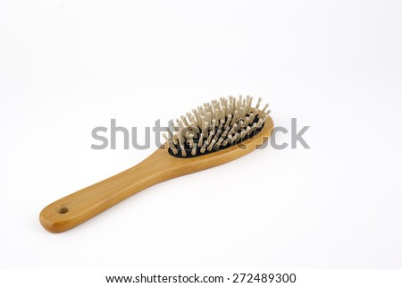 Wooden hair brush isolated on white background - stock photo