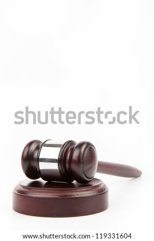 Wooden hammer and gavel on white background