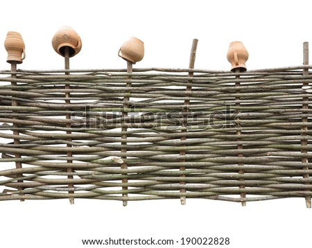 Wooden handmade fence at ranch isolated over white background - stock photo