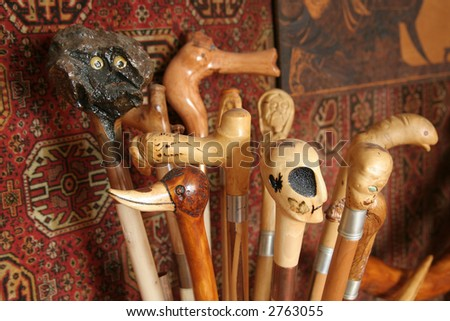 Wooden handmade sculpture canes - stock photo
