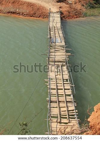 Wooden hanging bridge  - stock photo
