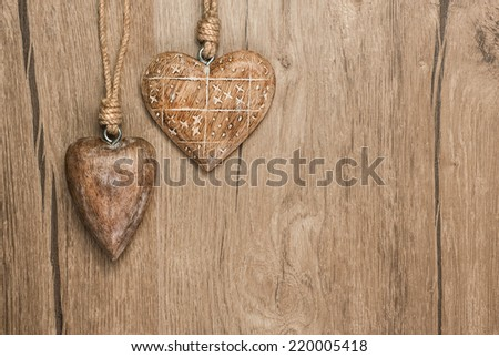 Wooden heart decorations on vintage oak background, space for your text  - stock photo