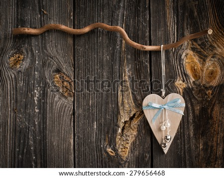 wooden heart hanging on a branch - stock photo