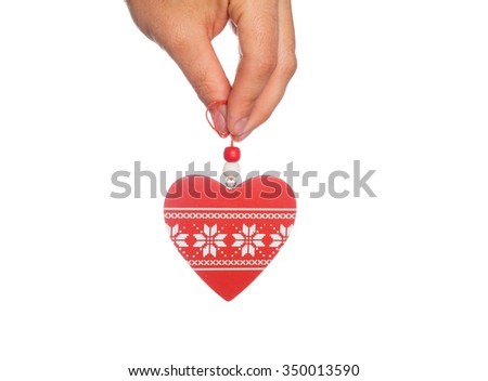 Wooden heart in his hand isolated on white background. - stock photo