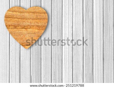 wooden heart on white wooden background - stock photo