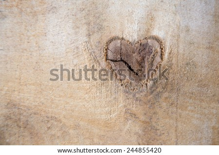 wooden heart on wood background - stock photo