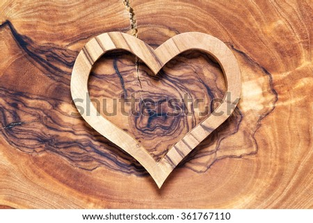 wooden heart on wooden background, horicontal with white vignette, lot of copyspace - stock photo