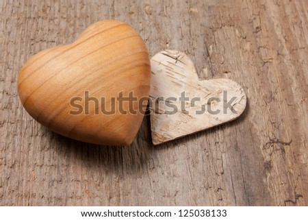 Wooden heart symbol on wooden background