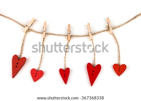 Wooden hearts on clothespins on white background. Post card for the Valentine. Button love. Wooden buttons. Valentine's Day postcard. Red valentine hearts. - stock photo