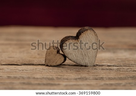 wooden hearts placed nicely on vintage wood background - stock photo