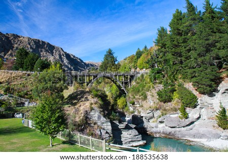 Wooden historic bridge over the shotover river, Queenstown, New Zealand - stock photo