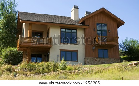 wooden home on a hill in the mountains - stock photo
