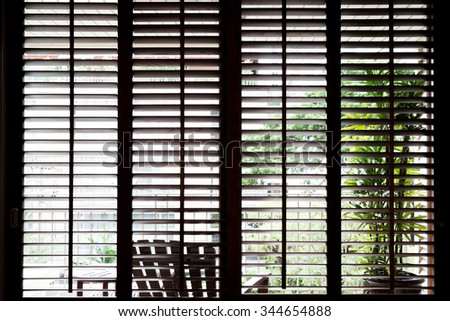 Wooden horizontal jalousie , dark - stock photo