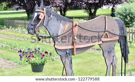 Wooden horse in the garden - stock photo