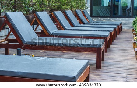 Wooden horse long seats near the pool, Wooden Pool beds - closeup.