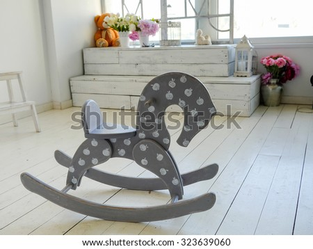wooden horse on the floor in vintage interior