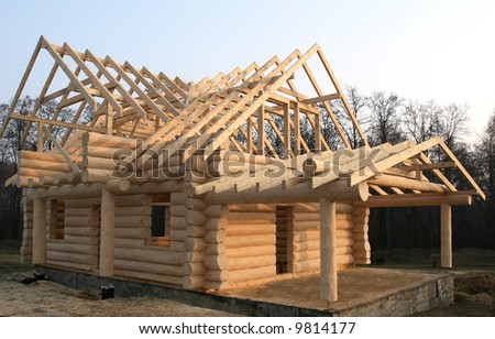 Wooden house construction. Residential architecture. Environment friendly building.