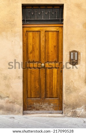 Wooden, house door in Tuscany region  - stock photo