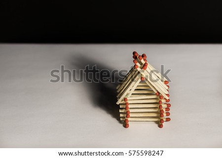 Wooden House From Matches   Model Of Safe Living With Insurance On Black  Background