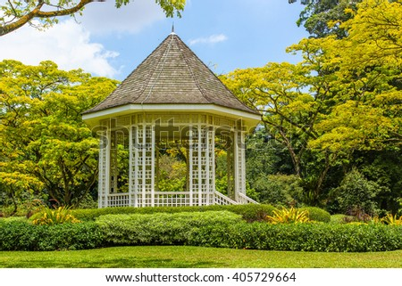 Wooden house gazebo in the colorful tropical garden - stock photo
