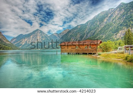 wooden house in a mountain lake HDR - stock photo