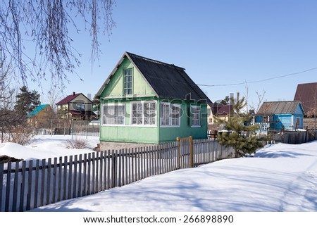wooden house in a winter day - stock photo