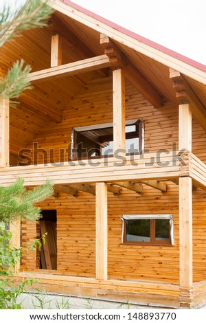 wooden house in the woods under construction - stock photo